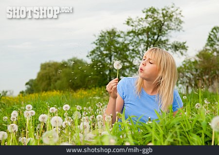 Young Woman, Dandelion, Blowing